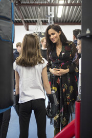Meghan Markle looked lovely in a printed maternity dress by Oscar de la Renta while visiting Bristol.