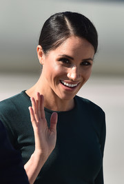 Meghan Markle arrived on a flight in Dublin for her official two-day visit wearing this classic side-parted bun.