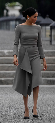 Meghan Markle looked refined in a gray Roland Mouret dress with a bateau neckline and a draped skirt during her visit to Ireland.