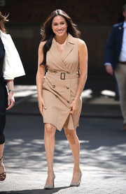 Meghan Markle looked simply stylish in a sleeveless nude trench dress by Banana Republic while visiting the University of Johannesburg.