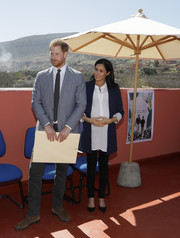 Meghan Markle teamed a navy Alice + Olivia blazer with a white blouse and black pants for Michael McHugo's investiture in Morocco.