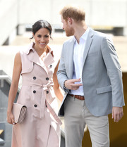Meghan Markle accessorized with a pale pink Mulberry clutch to match her coat at the Nelson Mandela Centenary Exhibition.