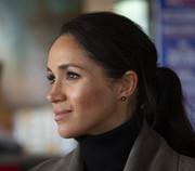 Meghan Markle adorned her lobes with simple gold studs by Boh Runga.