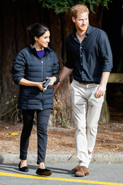 Meghan Markle kept warm with a navy puffer jacket by Norrona while visiting Rotorua's Redwoods Treewalk in New Zealand.