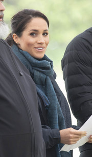 Meghan Markle stayed warm with a blue cashmere scarf by Loro Piana while visiting the Abel Tasman National Park in New Zealand.