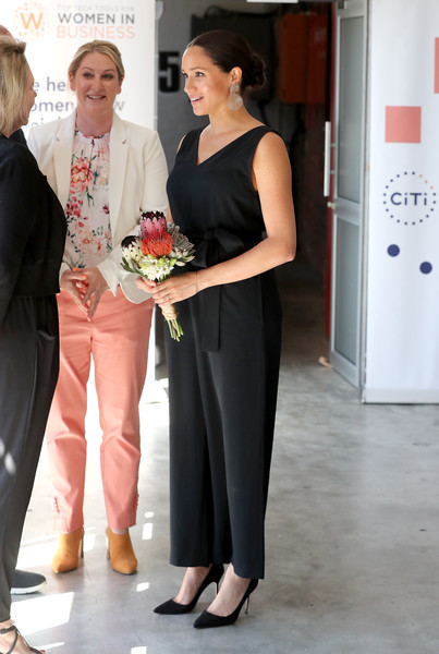 Meghan Markle visited Woodstock Exchange in South Africa wearing a sleeveless black jumpsuit by Everlane.