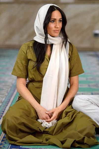 Meghan Markle accessorized with a white headscarf by Cuyana during her visit to Auwal Mosque in South Africa.