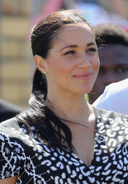 Meghan Markle accessorized with a pair of turquoise studs by Jennifer Meyer.