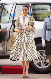 Meghan Markle looked fetching in a striped shirtdress by Martin Grant while visiting an exhibition of Tongan handicrafts.