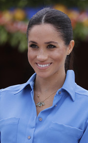 Meghan Markle wore a necklace with three blue stone pendants to complement her dress.