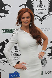 Maria Fowler accessorized with a lovely pair of dangling diamond earrings at the Duke of Essex Polo.