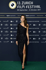 Alessandra Ambrosio made an ultra-sophisticated choice with this sparkly black one-shoulder gown by Rasario for the Zurich Film Festival premiere of 'Dyson.'