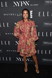 Karrueche Tran posed on the black carpet wearing a Zimmermann floral frock with waist cutouts at the E!, ELLE, and IMG NYFW kickoff celebration.