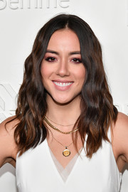 Chloe Bennet was hippie-glam with her center-parted waves at the NYFW kickoff party.