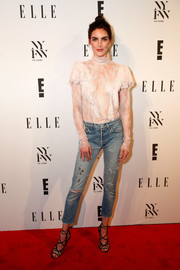 Hilary Rhoda contrasted her girly top with distressed jeans by Levi's.