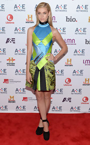 Nicola Peltz rocked a totally modern patchwork frock with a high neckline while at the A&E Upfront Event.
