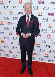 Tim Gunn showed off in impeccable style with this pinstripe suit and red tie.