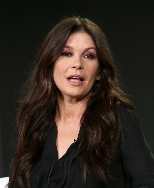 Catherine Zeta-Jones left her hair loose in a boho wavy style at the 2018 Winter TCA Press Tour.