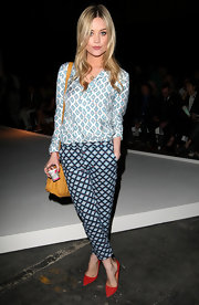 Laura Whitmore rocked an eclectic print-on-print look with this blouse and pants combo at the E. Tautz fashion show.