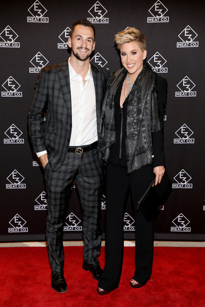 Savannah Chrisley jazzed up her look with a printed silver scarf.