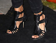 Courteney Cox dressed up her denim with a cool pair of black strappy sandals.