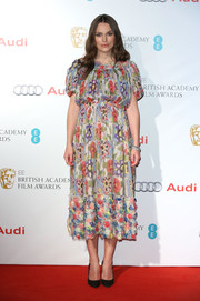 Keira Knightley looked adorable in a colorful floral maternity dress by Chanel at the EE British Academy Awards nominees party.