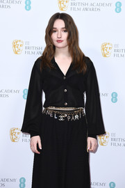 Kaitlyn Dever adorned her black dress with layers of Chanel belts for the 2020  EE British Academy Film Awards nominees party.