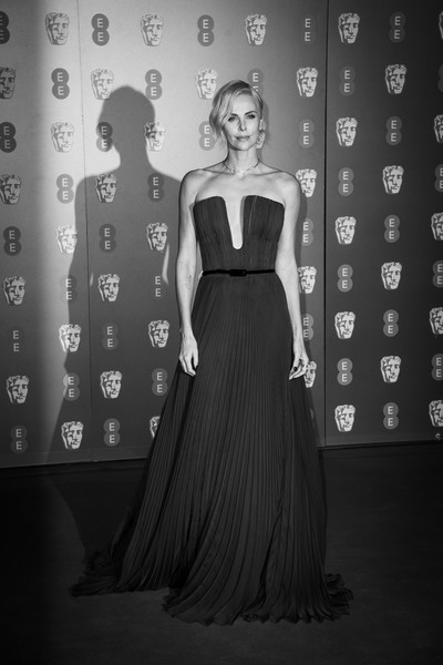 More Pics of Charlize Theron Strapless Dress (2 of 25) - Dresses & Skirts Lookbook - StyleBistro [image,dress,black,clothing,fashion,black-and-white,gown,lady,haute couture,beauty,fashion model,charlize theron,british academy film awards,ee,england,london,royal albert hall,red carpet arrivals,charlize theron,73rd british academy film awards,royal albert hall,fashion,british academy of film and television arts,lookbook,fashion show,model,strapless dress]