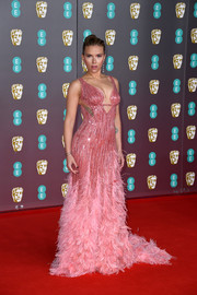 Scarlett Johansson went full-on glam in a beaded and feathered pink gown by Atelier Versace at the 2020 EE British Academy Film Awards.