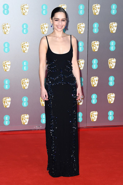Emilia Clarke went for understated elegance in a beaded black slip gown by Schiaparelli Couture at the 2020 EE British Academy Film Awards.