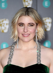 Greta Gerwig wore her hair in a stylish razor cut at the 2020 EE British Academy Film Awards.