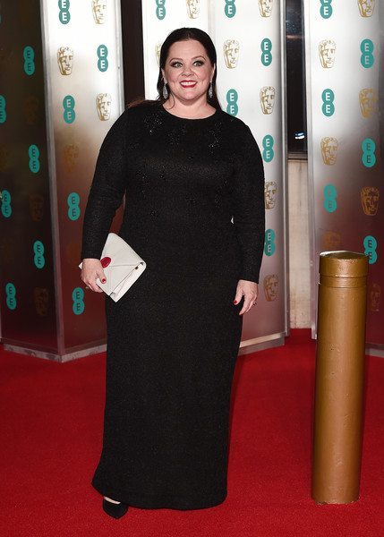 Melissa McCarthy added a bright spot with a white envelope clutch.
