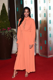 Laura Harrier opted for a peach keyhole-cutout gown by Louis Vuitton when she attended the EE British Academy Film Awards.
