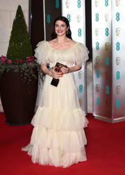 Rachel Weisz looked angelic in a cream-colored ruffle gown by Gucci at the EE British Academy Film Awards.