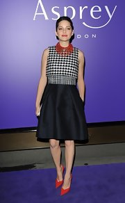 Marion looked as retro-ly charming as ever in this houndstooth dress at the BAFTA nominees party.