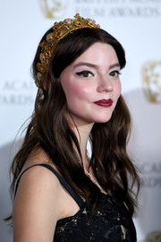 Anya Taylor-Joy channeled her inner princess with this gold crown by Dolce & Gabbana.