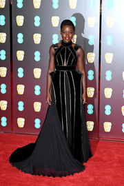 Lupita Nyong'o looked resplendent in an Elie Saab Couture paneled gown with metallic piping and a sweeping train at the EE British Academy Film Awards.