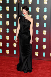 Gemma Arterton was the picture of elegance in a pleated black one-shoulder gown by Alberta Ferretti Limited Edition Couture at the EE British Academy Film Awards.