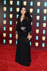 Salma Hayek was classic and feminine at the EE British Academy Film Awards in a black Gucci gown with floral beading on the shoulders, cuffs, and waistline.
