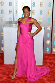 Regina King looked fabulous in an asymmetrical hot-pink gown by Atelier Versace at the EE British Academy Film Awards.