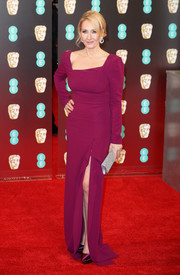 J.K. Rowling attended the 2017 BAFTAs wearing a magenta Roland Mouret gown with an asymmetrical neckline and a thigh-high slit.