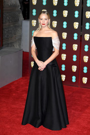 Jennifer Lawrence looked like a princess in a black Dior Couture off-the-shoulder gown with contrast sleeves at the EE British Academy Film Awards.