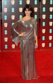 Penelope Cruz looked downright divine in a draped off-one-shoulder chainmail gown by Atelier Versace at the 2017 BAFTAs.