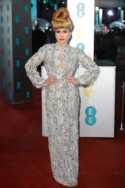 Believe it or not, this was a quiet look for Paloma Faith. Generally in exuberant colors and funky fashions, the singer wore a beautiful silver blue beaded gown anyone would love to wear. Her hair, of course, was in keeping with her zany style.