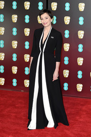 Kristin Scott Thomas went minimalist yet elegant in a black-and-white V-neck gown by Dior Couture at the EE British Academy Film Awards.