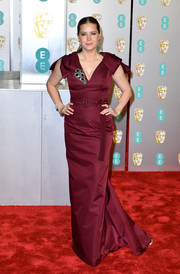 Amy Adams cut an elegant figure in a burgundy Prada gown with bowed shoulders at the EE British Academy Film Awards.