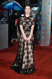 Lily James looked classically romantic in this vintage-y black lace dress with short delicate sleeves. Very Kate Middleton, no?