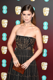 Kate Mara paired a metallic box clutch with a strapless dress, both by Dior, for the EE British Academy Film Awards.