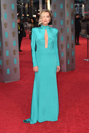 Laura Whitmore stunned at the BAFTAs in a Tiffany-blue gown with a cleavage-baring cutout.