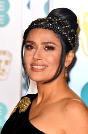 Salma Hayek styled her hair into a voluminous bun for the EE British Academy Film Awards.